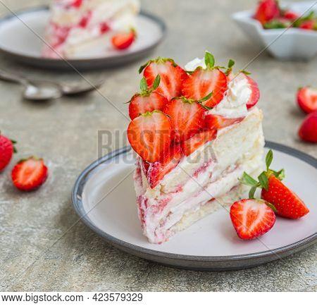 Dessert, Sliced Sponge Cake With Custard, Fresh Strawberries And Whipped Cream On A Gray Concrete Ba