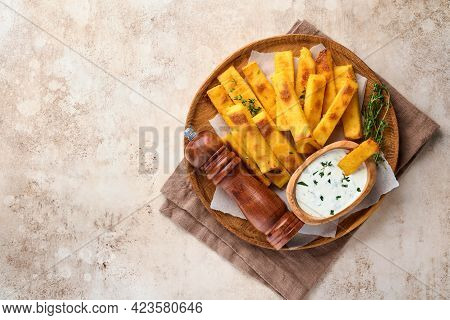 Homemade Polenta Chips Fries With Sea Salt, Parmesan, Thyme, Rosemary With Yogurt Sauce. Typical Ita