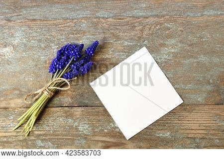 Bouquet Of Bright Spring Flowers Hyacinth Tied With Twine And White Paper Sheet On Old Rustic Wooden