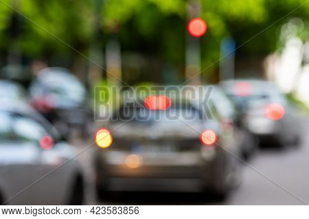 Abstract Defocused Traffic On City Street, Urban Blurred Background With Copy Space