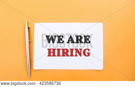 Notes With The Inscription We Are Hiring And A Pen. Employee Search. Attraction To Work. Human Resou