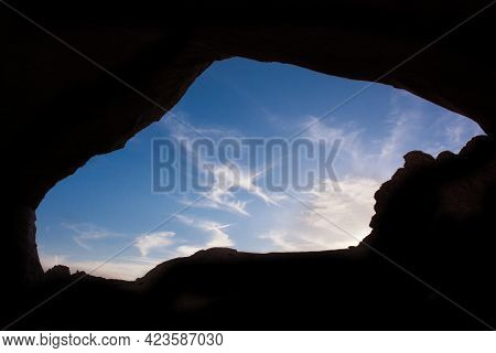 Sky Through A Cave Opening. Sky View In The Opening Of Cave.