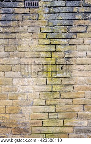 Old Damp Stained Exterior Wall Made Of Brown Sandstone Blocks