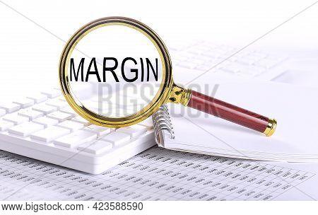 Margin Word Through Magnifying Glass On Keyboard On Chart