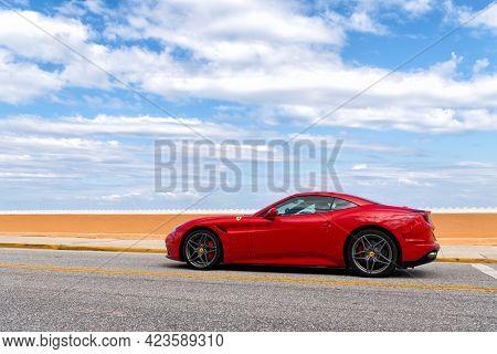 Palm Beach, Florida Usa - March 21, 2021: Ferrari California Luxury Car Moving On Road