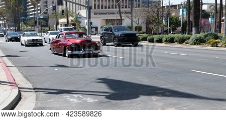 Long Beach, California Usa - April 11, 2021: Red Chevrolet Kustom. Luxury Life. Business Trip.