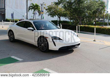 Miami Beach, Florida Usa - April 15, 2021: White Porsche Taycan Turbo S Luxury Sport Car