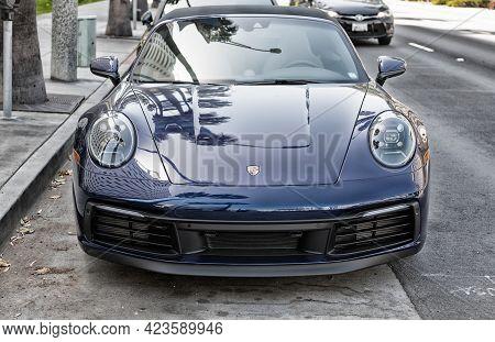 Long Beach, California Usa - April 11, 2021: Dark Blue Porsche 911 Carrera Cabriolet. Front View.