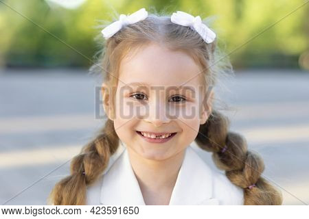 Little Girl Smiling Without Front Milk Tooth, Permanent Molar Grow. Dental Hygiene Concept. Closeup