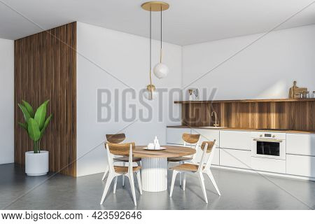 Light Kitchen Set With Round Dining Table And Four Chairs On Grey Floor, Side View. Minimalist Inter
