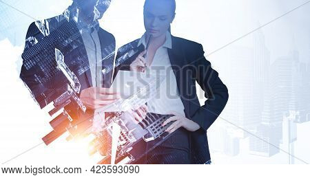 Businessman And Businesswoman In Black Suit Serious Look, Analysing Paper Document. Business Buildin