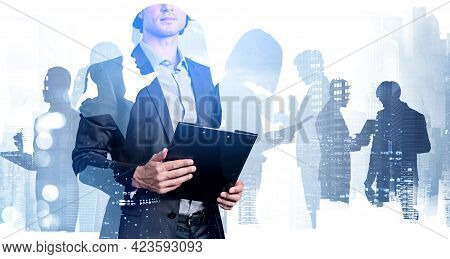 Office Man In Business Suit Holding Documents, Toned Image, Double Exposure Of Business Buildings. C