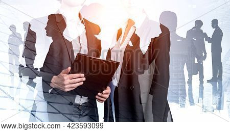 Office People Holding Business Files, Documents, Double Exposure Of Business Buildings And Silhouett