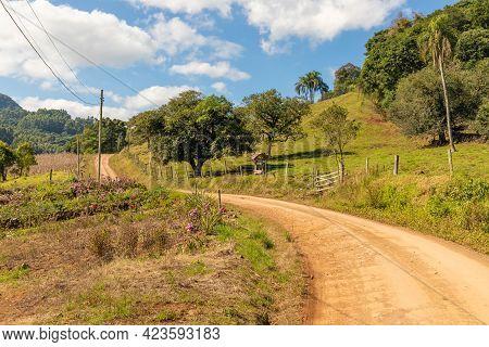 Dirty Road With Farm Field And Small Garden Around, Pinhal Alto, Nova Petropolis, Rio Grande Do Sul,