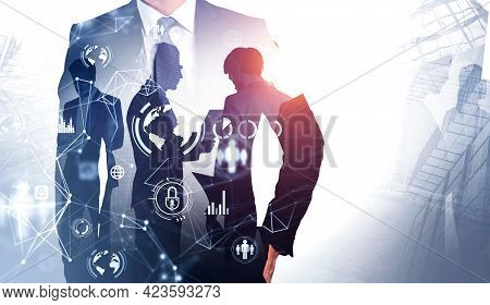 Front View Of Businessman In In Suit With Hand In Pocket. Double Exposure And Working Colleagues On