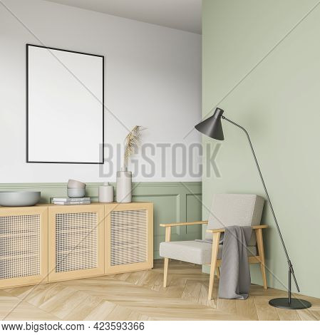 Green And White Reading Room Interior With Grey Armchair And Lamp, Wooden Commode With Books And Vas
