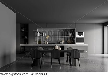 Black Kitchen Room With Black Table And Six Chairs, Front View, Concrete Floor. Cooking Set Interior