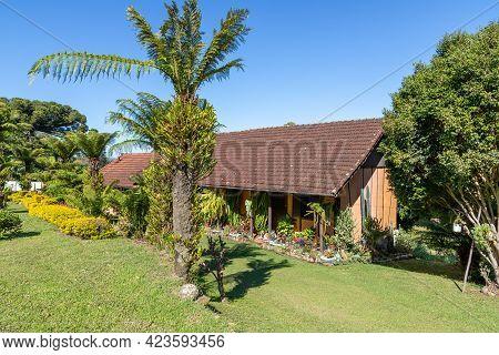 Small House And Garden With Grass, Flowers, Trees And A Dog, Pnhal Alto, Nova Petropolis, Rio Grande