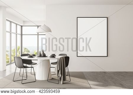 Interior Of Modern Dining Room With White Walls, Concrete Floor, Panoramic Window And Round Table Wi