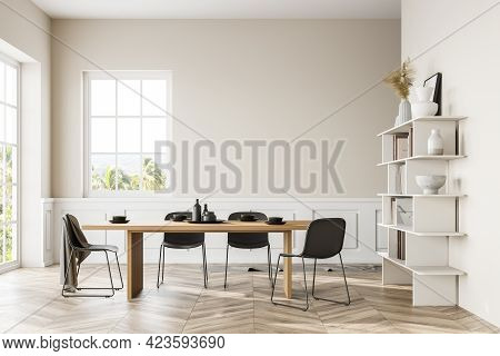 Interior Of Modern Dining Room With White Walls, Wooden Floor, Long Table And Bookcase. 3d Rendering