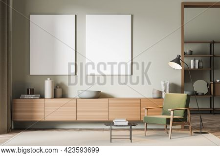 Reading Art Room Interior With Wooden Commode With Books And Vase, Green Armchair And Coffee Table O