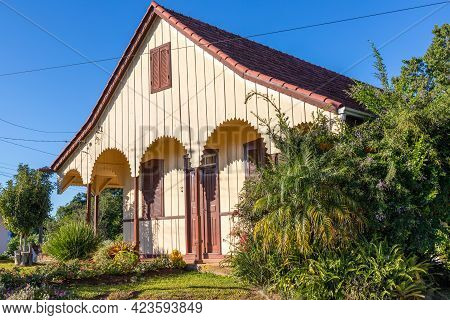 Old Wood House With Colorful Garden