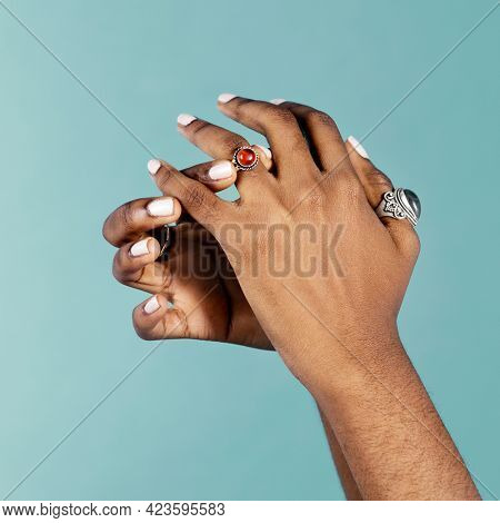 Feminine hands putting a ring on a ring finger