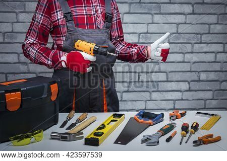 Handyman Ready For Work. Repairman With Different Tools Gesturing Thumbs Up. Repair Concept.