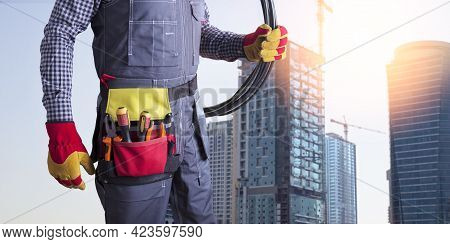Electrician Worker With Wiring And Tools At Construction Site. Installation Power System. Banner.