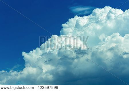 Overcast Blue Sky With Fluffy Cloudy And Blue Light