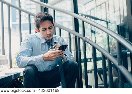 Unemployed People Are Tired On Hot Days Using Mobile Phones To Search For Jobs, Interview. Quitting