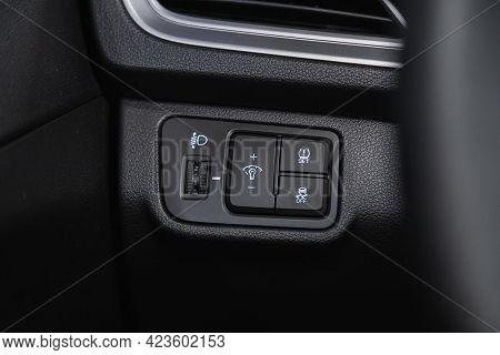 Novosibirsk, Russia - June 08, 2021: Hyundai Solaris, Close-up Of Black   Headlight Buttons On Car P