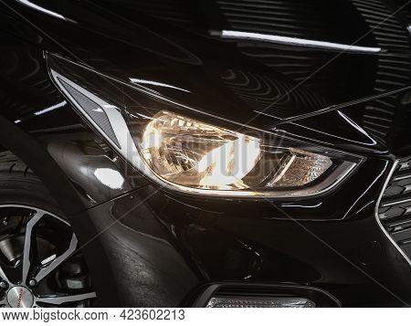 Novosibirsk, Russia - June 08, 2021: Hyundai Solaris,  Close Up Of The Car Headlights. Exterior Clos