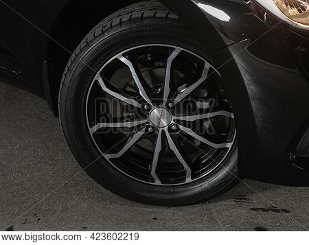Novosibirsk, Russia - June 08, 2021: Hyundai Solaris, Car Wheel On Black Car - Close Up