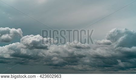 Panorama View Of Overcast Sky. Dramatic Gray Sky And White Clouds Before Rain In Rainy Season. Cloud