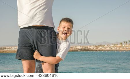 Father And  Son  Spending Time Together Sea Vacation. Father's Day. Young Man, Little Boy Walking Be