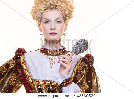 Haughty queen in royal dress isolated on white