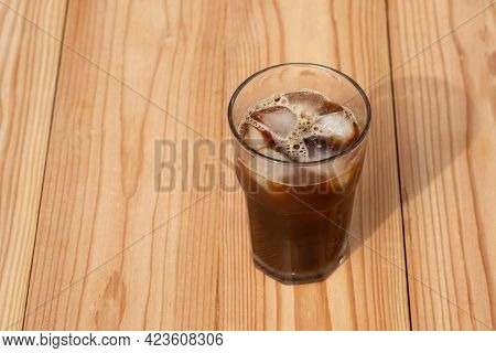 Americano Black Coffee On Wooden Table In The Morning. Iced Coffee.