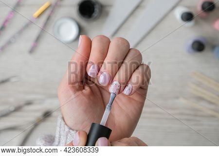 Modern Female Nude Design Manicure. Nail Care, Self Care. Do Manicure By Yourself While Staying At H