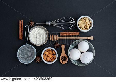 Baking Cooking Ingredients On Black Background. Top View. Frame Food Knolling. Home Baking: Cookies,