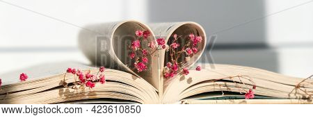 Book Pages Folded Into A Heart And Pink Flower. Soft Focus, Deliberate Slight Blurring. Delicate Pin