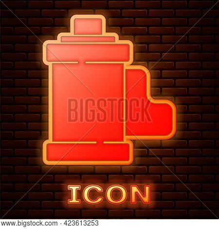 Glowing Neon Camera Vintage Film Roll Cartridge Icon Isolated On Brick Wall Background. 35mm Film Ca