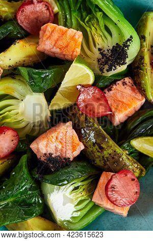 Salad With Artichokes, Avocado And Salmon Close-up, Large Segments Of Vegetables Avocado Artichokes