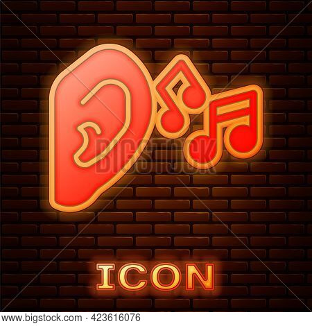 Glowing Neon Ear Listen Sound Signal Icon Isolated On Brick Wall Background. Ear Hearing. Vector