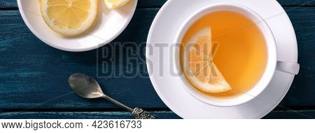 Lemon Tea Panorama On A Dark Blue Rustic Background. Natural Remedy In A Cup. Healthy Organic Citrus