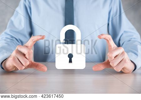 Businessman Holds An Open Padlock Icon On His Palm.unlocking A Virtual Lock. Business Concept And Te