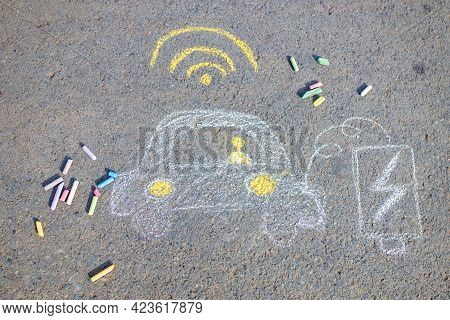 Little Girl With Creative Craft Hobby Drawing Electro On The Asphalt With Chalk Car Environment, Eco