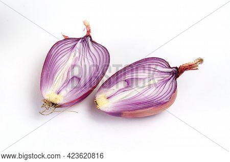 Two Halves Of A Ripe Raw Unpeeled Onion On A White Background. Italian Onion Ramata Di Milano. Cross