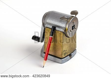Wooden Pencil And Vintage Sharpener On White Background. Manual Metal Tool For Sharpening Wooden Pen