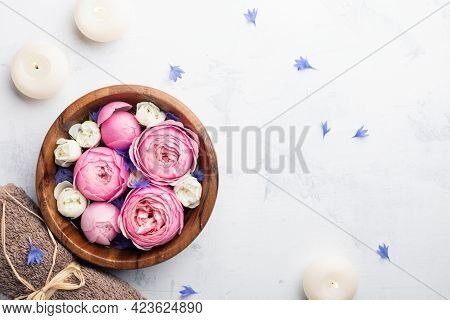 Beauty, Aromatherapy And Spa Background With Perfumed Water With Flowers In Wooden Bowl, Towel And C